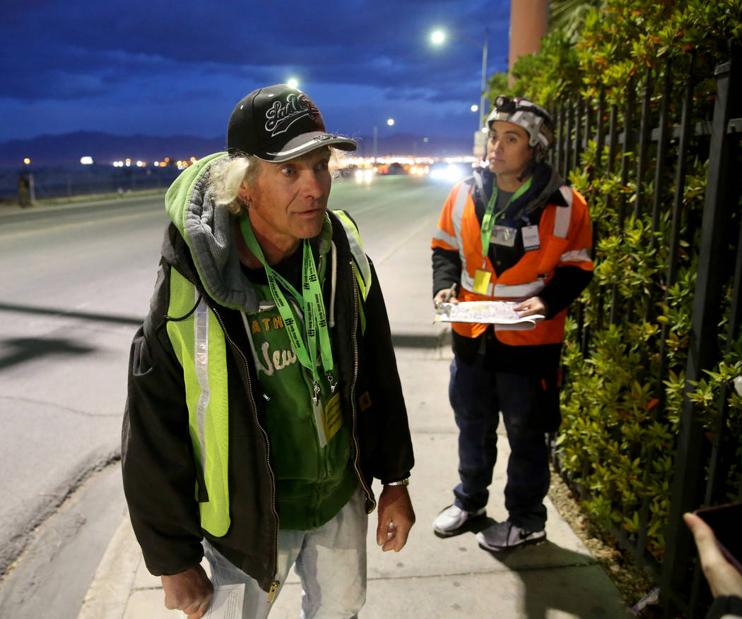 Homeless count volunteers Roger Peterson, left, and Daryl Meier, on Washington Avenue and Main ...