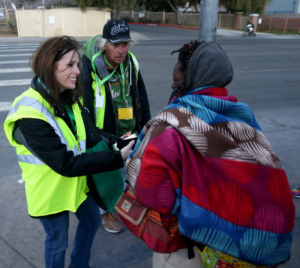 Homeless count volunteers Clark County Social Services grant administrator Shawna Thompson and ...