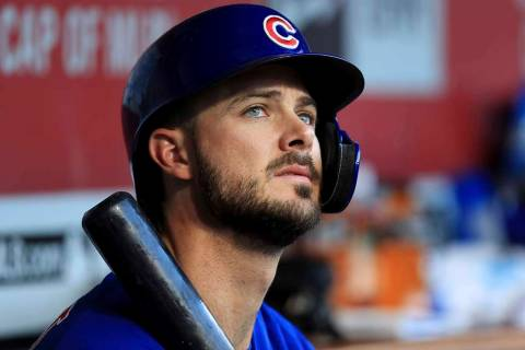 In this Aug. 10, 2019, file photo, Chicago Cubs' Kris Bryant (17) sits in the dugout during a b ...