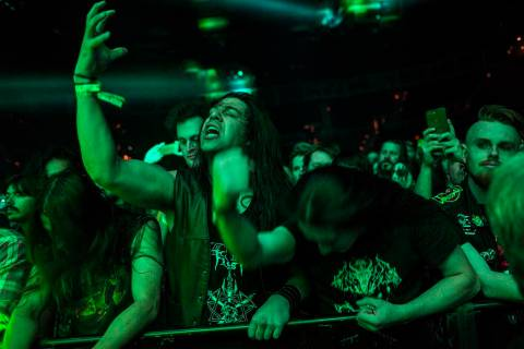 Fans react as Triumph of Death performs at the Mandalay Bay Events Center during the Psycho Las ...