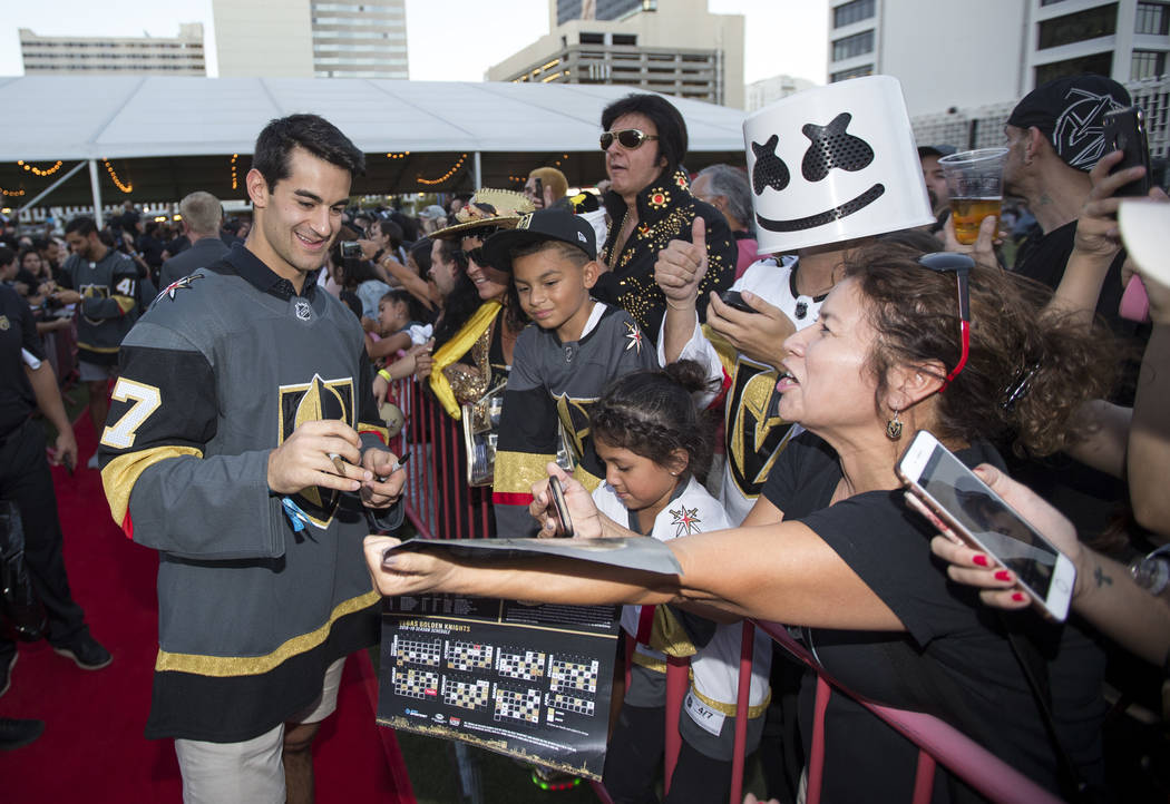Vegas Golden Knights left wing Max Pacioretty (67), left, signs autographs during a Vegas Golde ...
