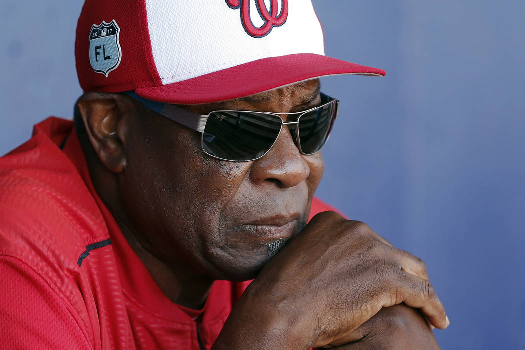 FILE - In this March 11, 2017, file photo, Washington Nationals manager Dusty Baker talks to re ...