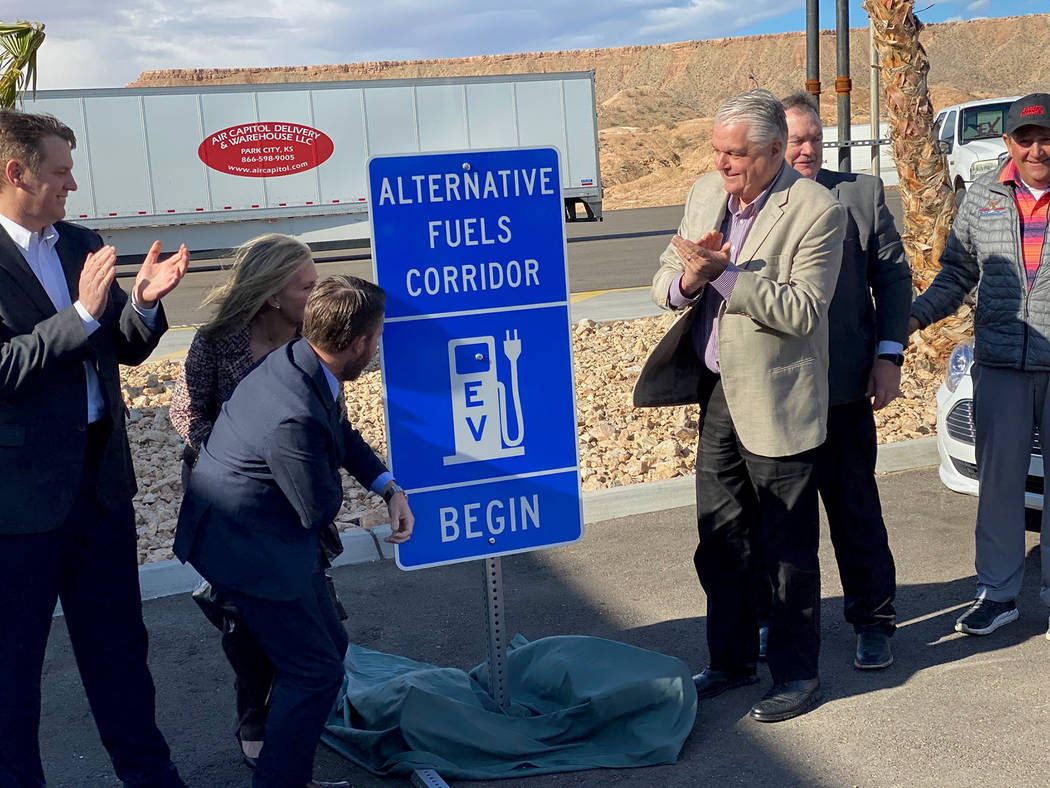 Gov. Steve Sisolak (third from right) and other dignitaries unveil Interstate 15 as an Electric ...