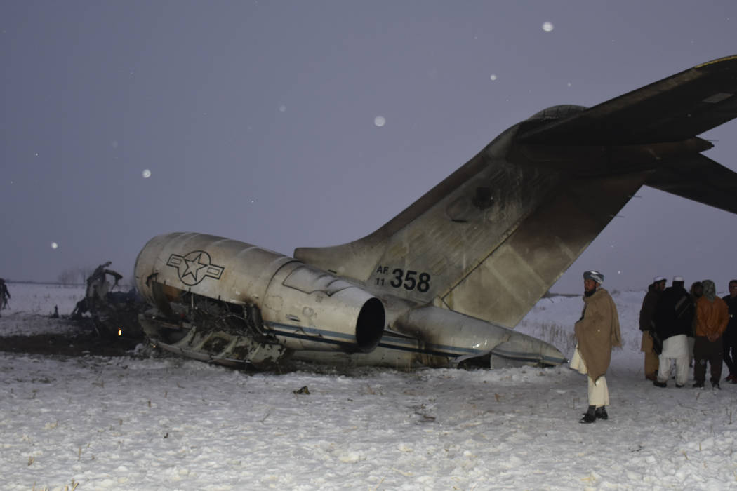 A wreckage of a U.S. military aircraft that crashed in Ghazni province, Afghanistan, is seen Mo ...