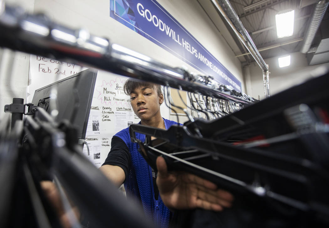 China Mitchell takes inventory of donated clothing at Goodwill of Southern Nevada on Wednesday, ...