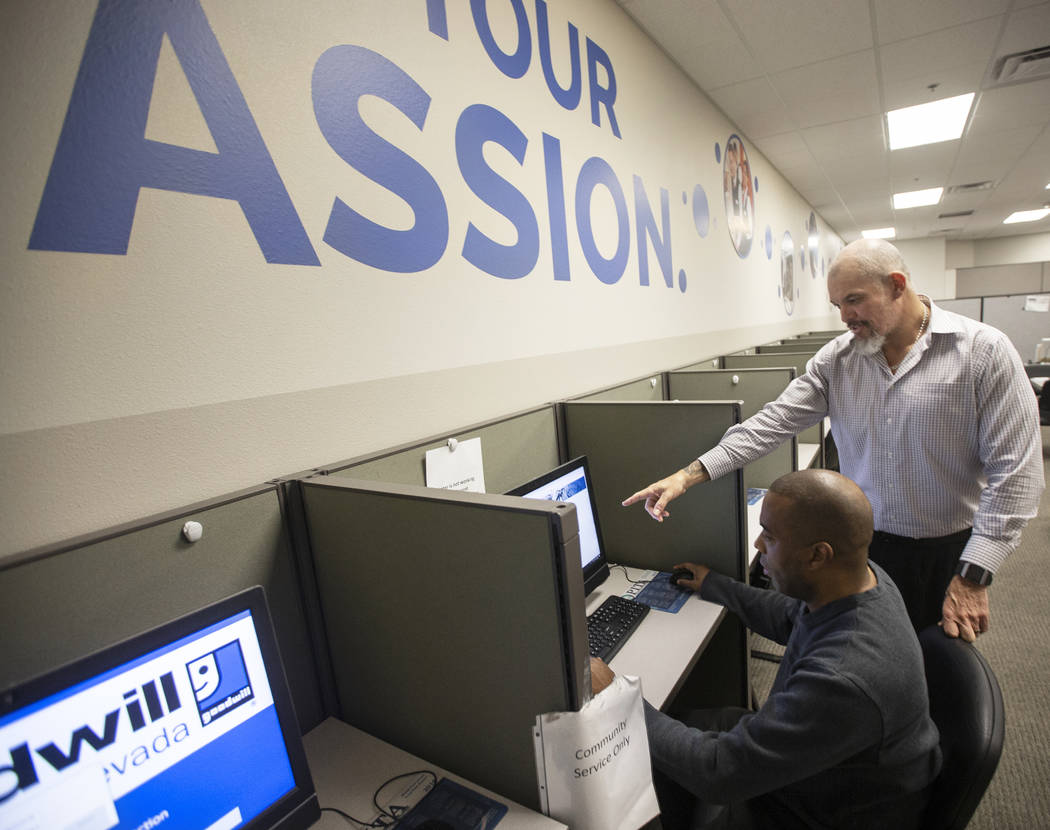 Marco Martinez, right, assists Donald Chapman at the Goodwill of Southern Nevada's career cente ...