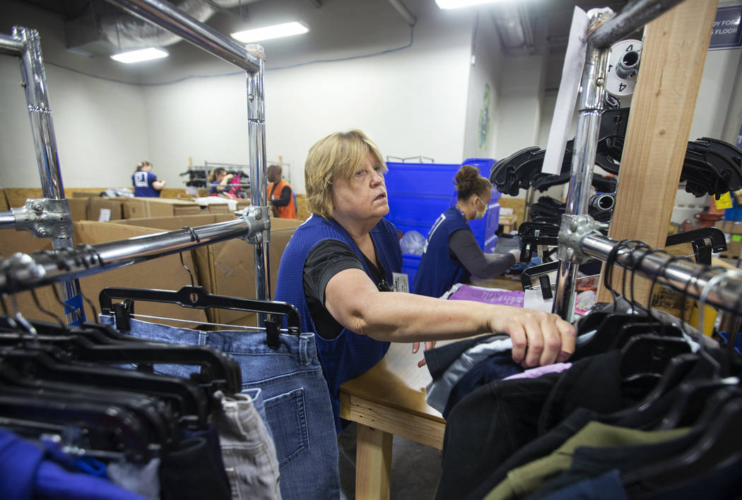 Linda Muth, left, sorts donated clothing at Goodwill of Southern Nevada on Wednesday, Jan. 29, ...
