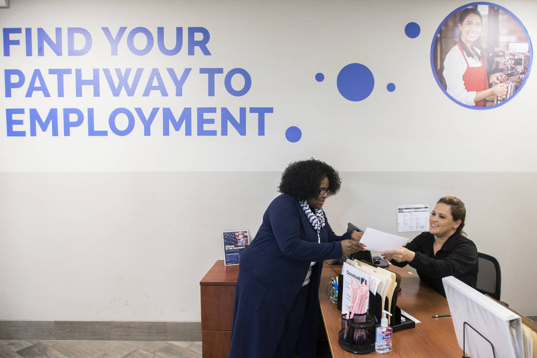 Martha Guizar, right, assists Wanda Freedie at the Goodwill of Southern Nevada's career center ...
