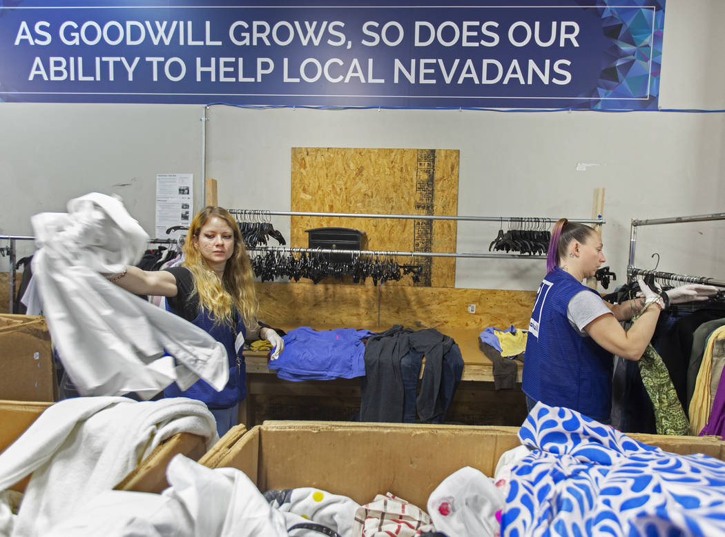 Shawnee Seay, left, and Katie Silber sort through donated clothing at Goodwill of Southern Neva ...