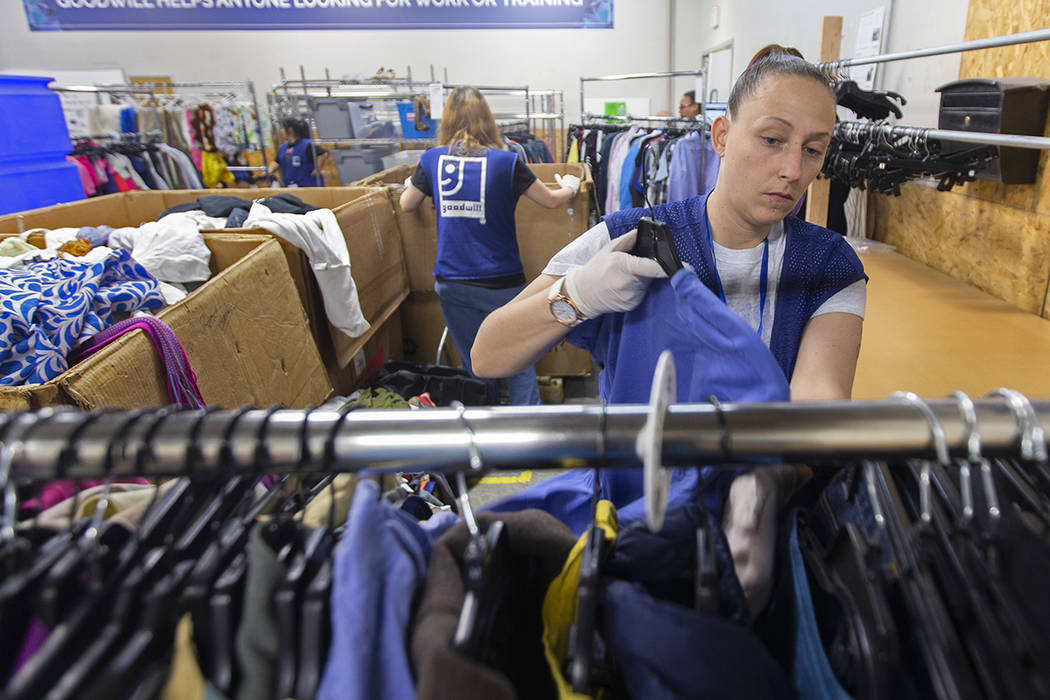Katie Silber sorts donated clothing at Goodwill of Southern Nevada on Wednesday, Jan. 29, 2020, ...