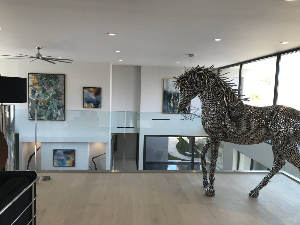 A horse sculpture on the second floor is part of the staging of the home. (Kimberly Joi McDonald)
