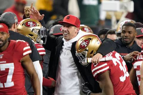 San Francisco 49ers head coach Kyle Shanahan, center, celebrates with players during the second ...