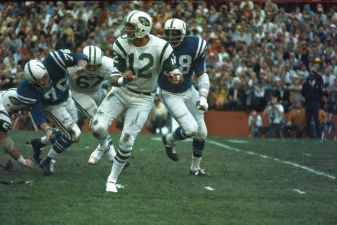 New York Jets quarterback (12) Joe Namath gets off a pass under pressure from the Baltimore Col ...