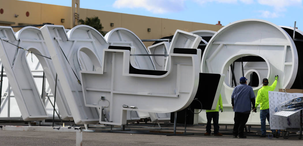 Workers store giant letters that's being built by Yescoon, a customized business signs maker, f ...