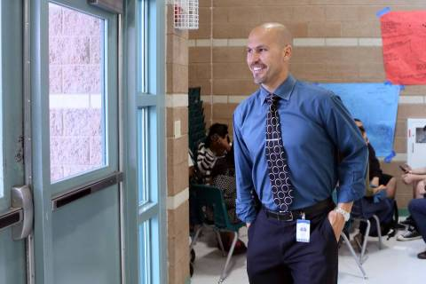 Principal Antonio Rael smiles as he walks away from a group of students he was speaking to whil ...