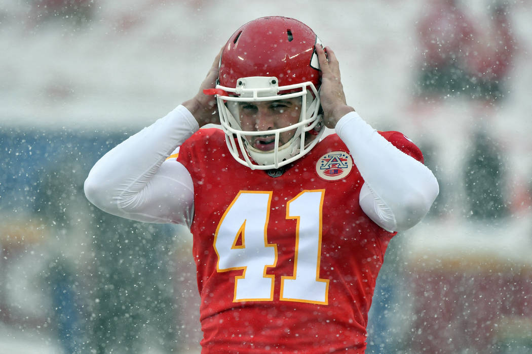 Kansas City Chiefs long snapper James Winchester (41) adjusts his helmet before an NFL division ...