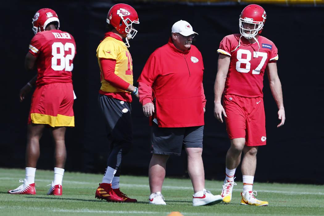 Kansas City Chiefs quarterback Patrick Mahomes (15) and tight end Travis Kelce (87) walk with h ...