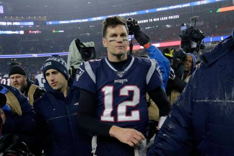 New England Patriots quarterback Tom Brady leaves the field after losing an NFL wild-card playo ...