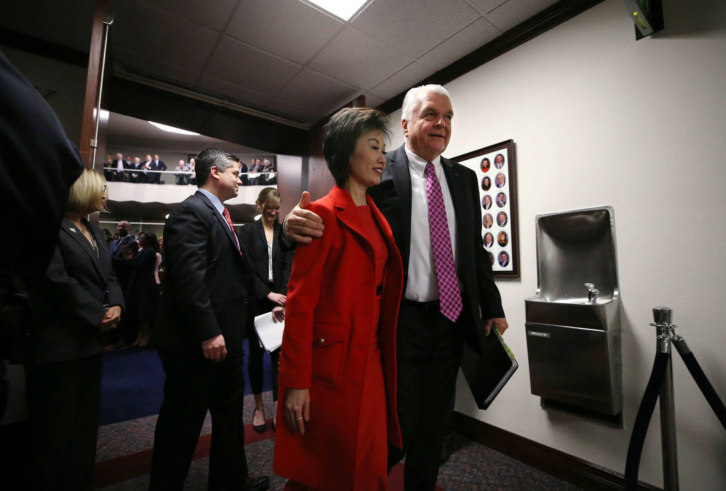 Nevada Gov. Steve Sisolak and his wife Kathy leave the Assembly chambers after delivering his S ...