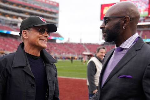 Actor Rob Lowe, left, talks with former wide receiver Jerry Rice before the NFL NFC Championshi ...