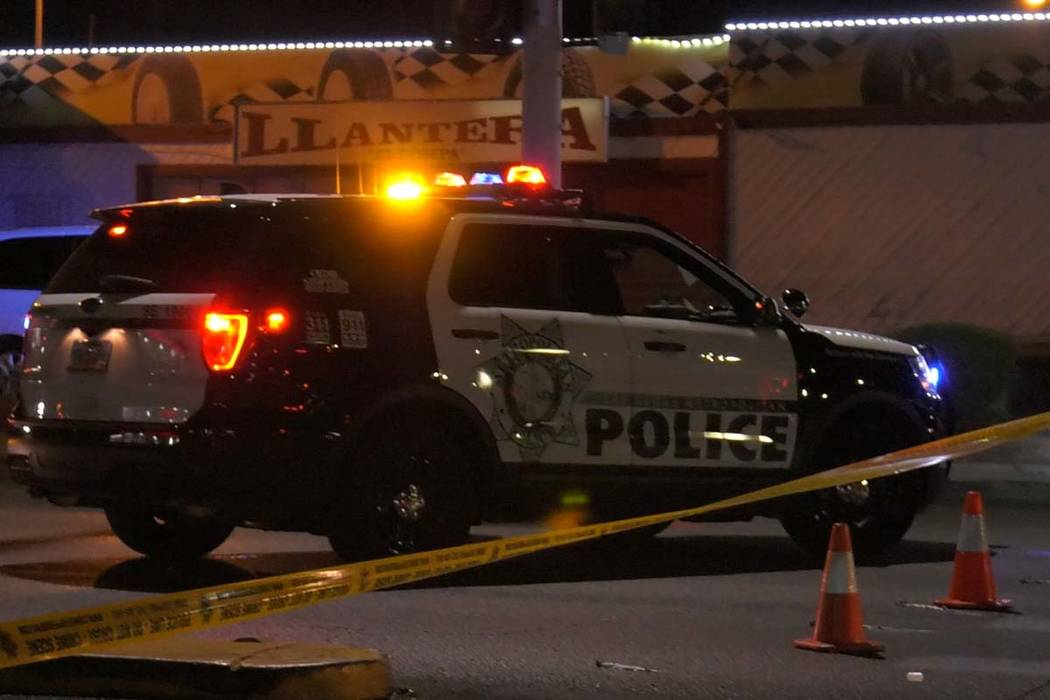 Las Vegas police investigate a body found in the intersection at North Lamb Boulevard and Stewa ...