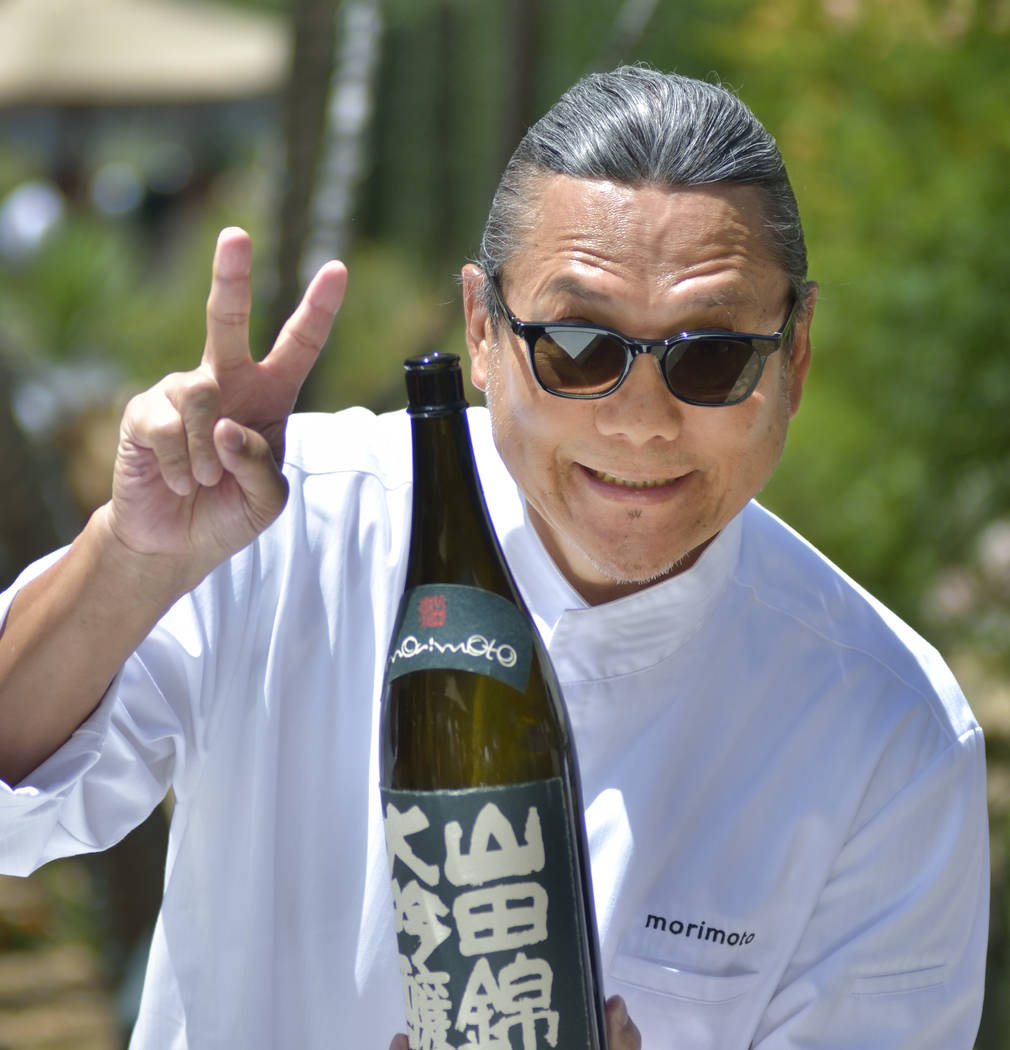 Chef Masaharu Morimoto is shown with a bottle of his sake during Picnic in the Park at the Park ...