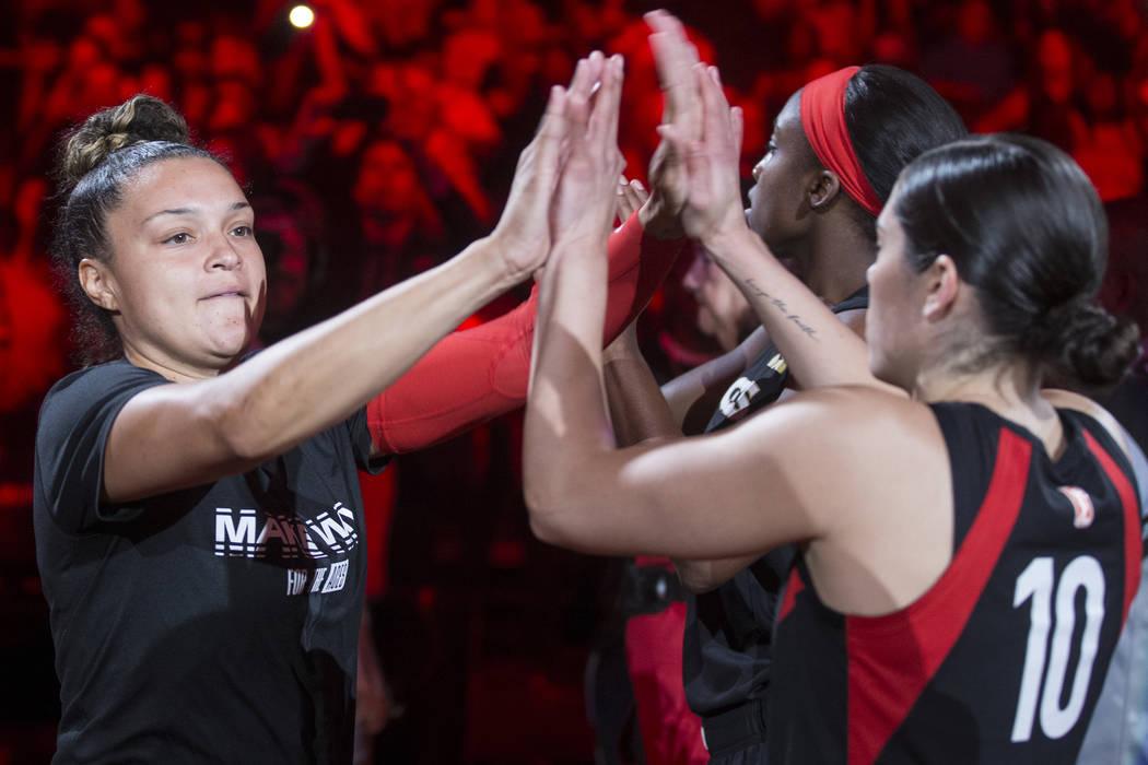 Las Vegas Aces guard Kayla McBride (21) high fives Las Vegas Aces guard Kelsey Plum (10) before ...