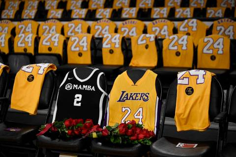 The jerseys of late Los Angeles Laker Kobe Bryant, right, and his daughter Gianna are draped on ...