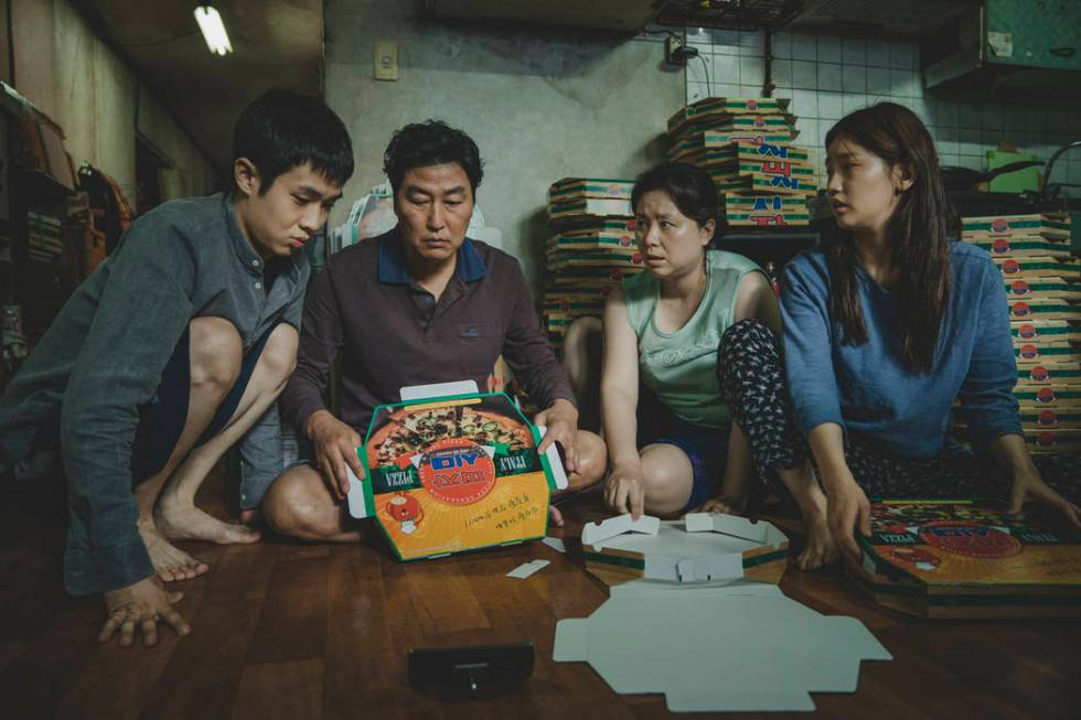 The Kim Family (Woo-sik Choi, Kang-ho Song, Hye-jin Jang, So-dam Park) in Parasite. (NEON CJ En ...