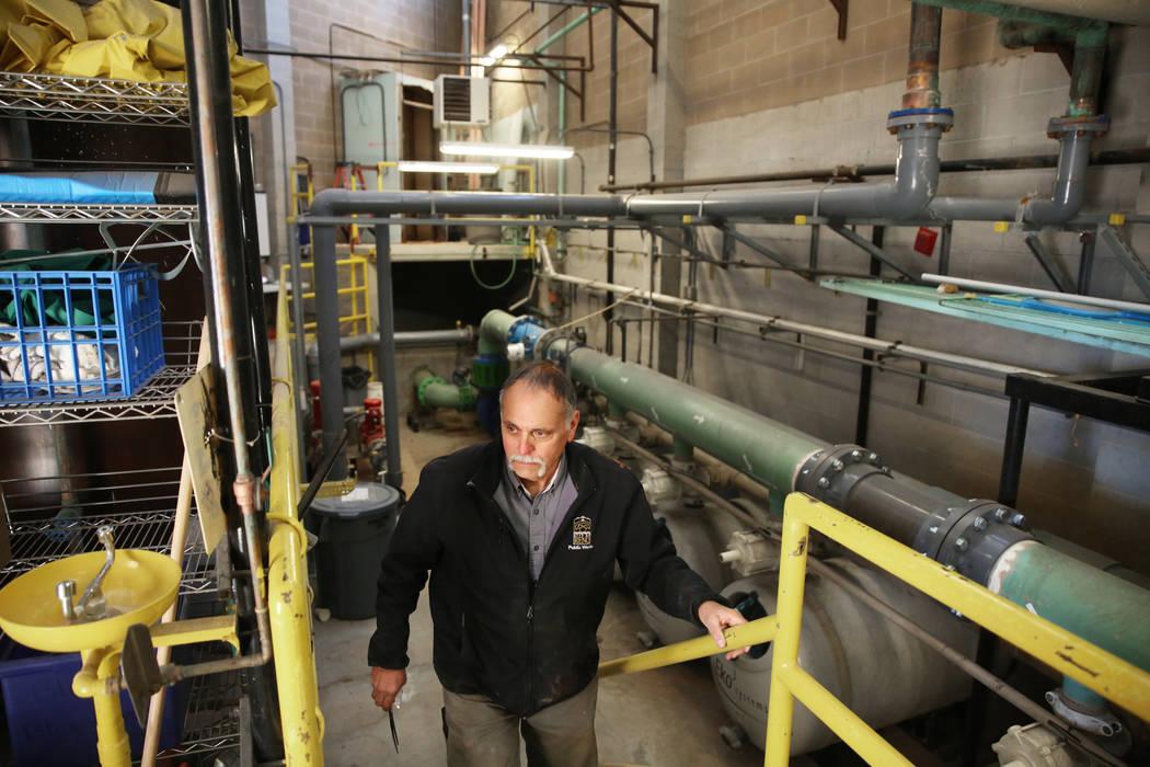 Maintenance tech Brad McClelland installs new acid tanks at Idlewild Pool on Monday, Jan. 6, 20 ...