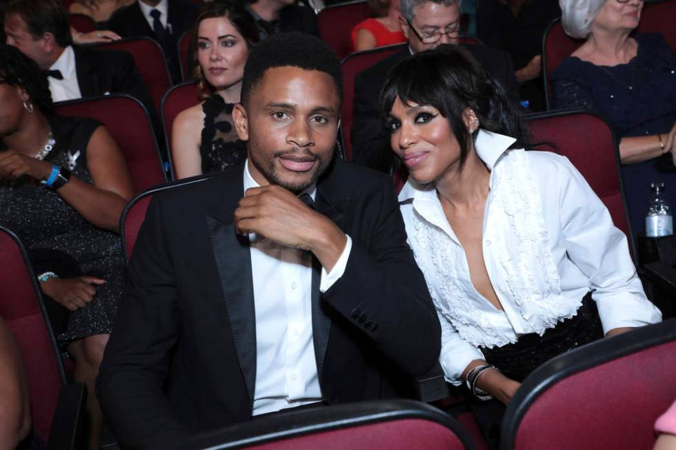 Nnamdi Asomugha, left, and Kerry Washington pose in the audience at the 71st Primetime Emmy Awa ...