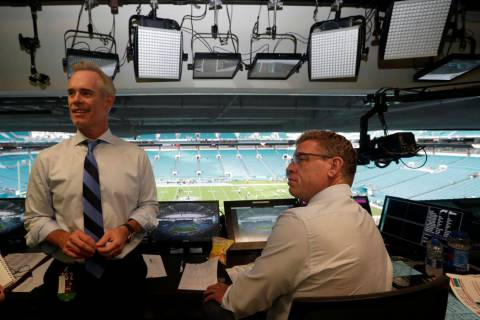 In this Friday, Aug. 23, 2019, photo, Fox Sports play-by-play announcer Joe Buck, left, and ana ...