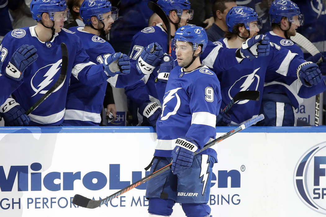 Tampa Bay Lightning center Tyler Johnson (9) celebrates with the bench after his goal against t ...