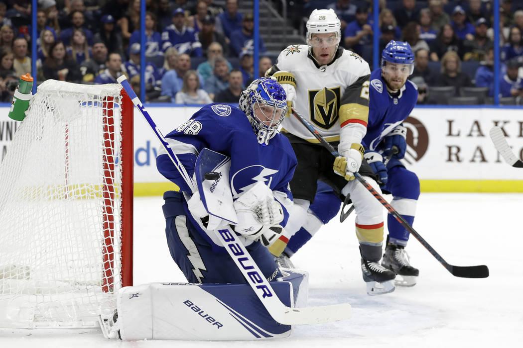 Tampa Bay Lightning goaltender Andrei Vasilevskiy (88) makes a blocker save as Vegas Golden Kni ...