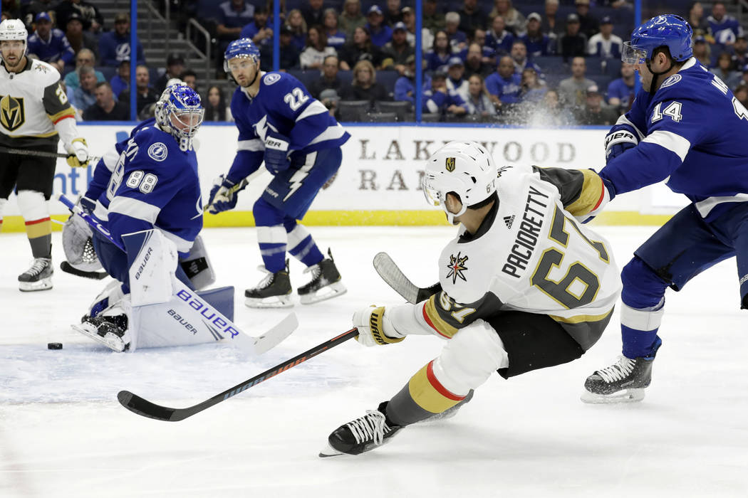 Vegas Golden Knights left wing Max Pacioretty (67) shoots behind Tampa Bay Lightning goaltender ...