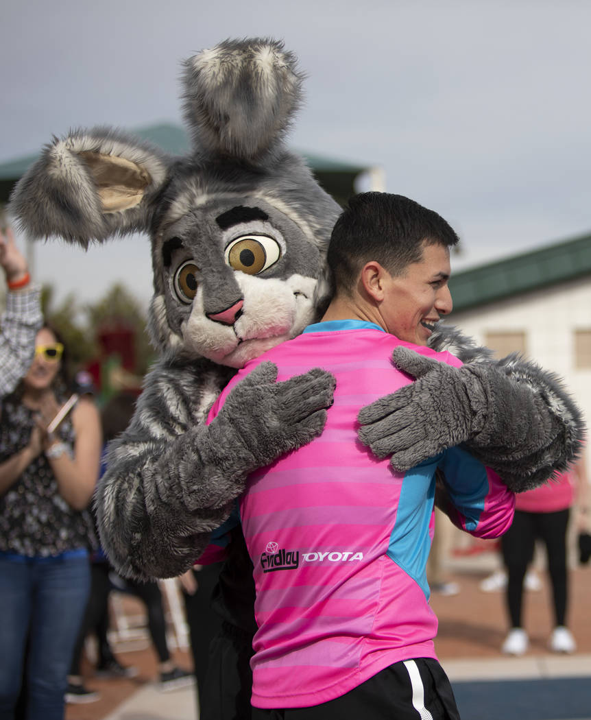 Las Vegas Lights goalkeeper Angel Alvarez gives the Las Vegas Aces mascot a post-workout hug at ...