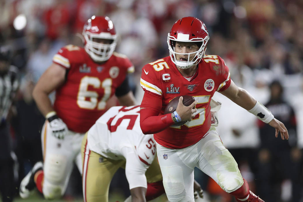 Kansas City Chiefs quarterback Patrick Mahomes (15) runs the ball up the field during the secon ...