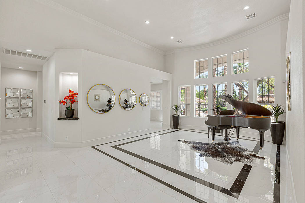 The home has a sophisticated modern design, incorporating the sleek palette of black and white. ...