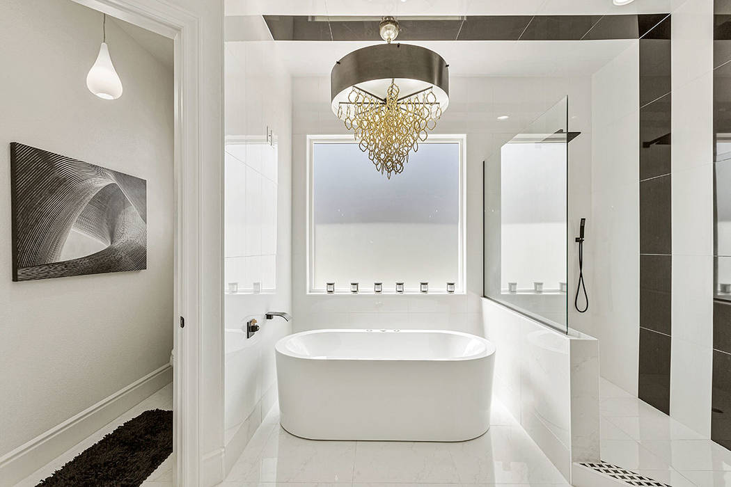 The master bath features a custom-made Roman tub imported from Italy. (Red Luxury Real Estate)