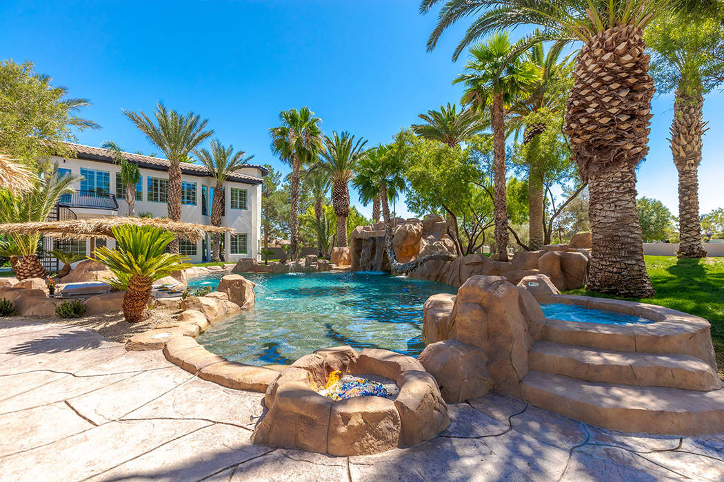 The backyard was designed as a resort. (Red Luxury Real Estate)