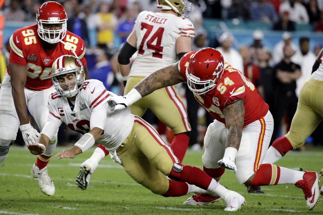 San Francisco 49ers quarterback Jimmy Garoppolo (10) is hit by Kansas City Chiefs' Mike Pennel ...