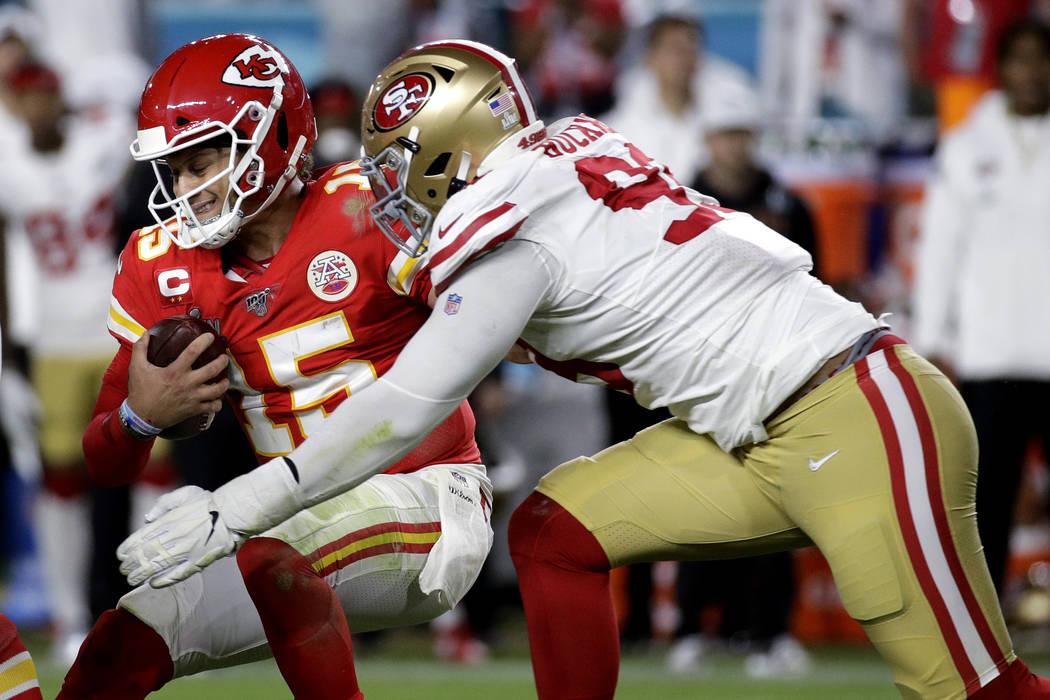 Kansas City Chiefs quarterback Patrick Mahomes (15) is sacked by San Francisco 49ers' DeForest ...