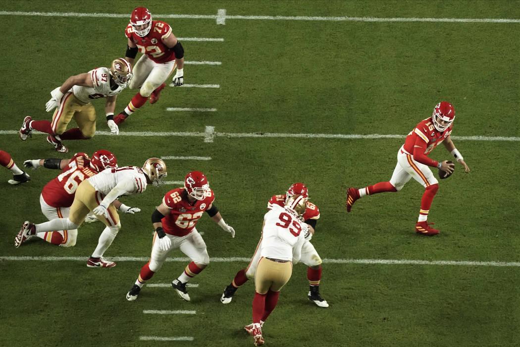 Kansas City Chiefs quarterback Patrick Mahomes (15) runs with the football, during the second h ...
