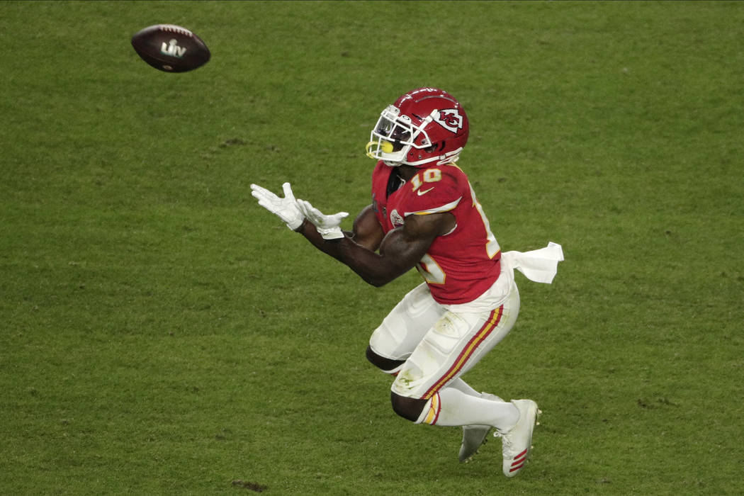 Kansas City Chiefs' Tyreek Hill (10) catches a pass, during the second half of the NFL Super Bo ...