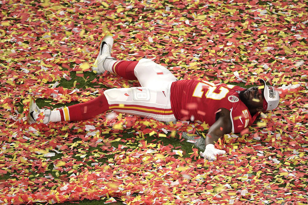 Kansas City Chiefs' Demone Harris (52) plays with the confetti, at the end of the NFL Super Bow ...