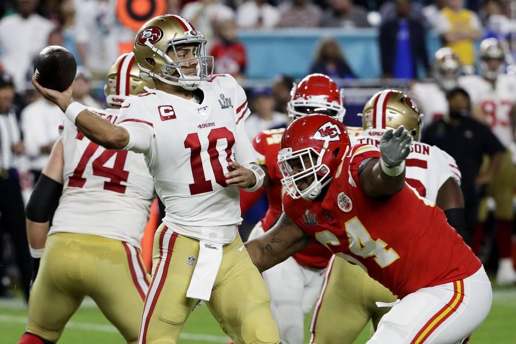 San Francisco 49ers quarterback Jimmy Garoppolo (10) is pressured by Kansas City Chiefs' Mike P ...