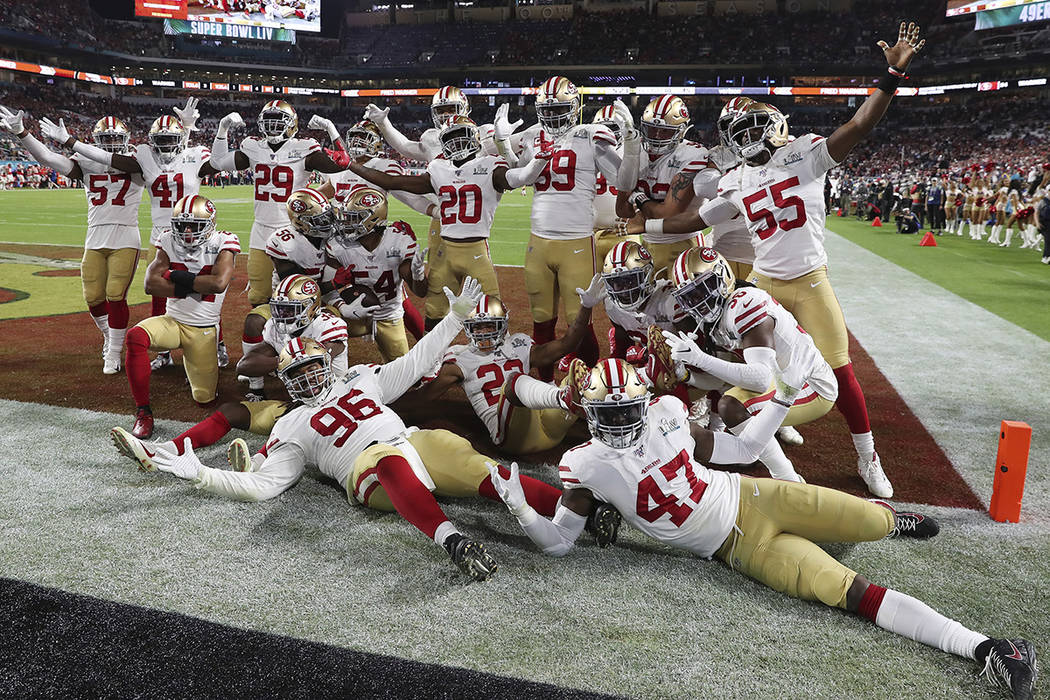 San Francisco 49ers celebrate after middle linebacker Fred Warner (54) intercepted a pass in th ...