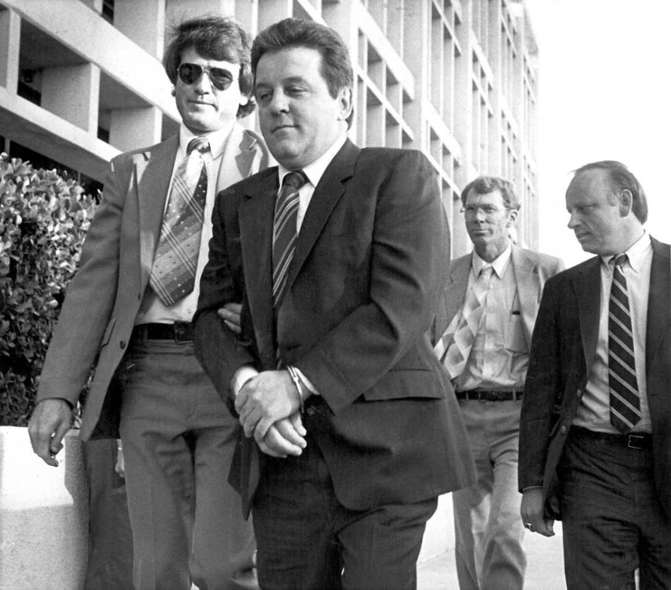 """Mobster Anthony """"The Ant"""" Spilotro is taken into custody in Las Vegas on Oct. 11, 1987. (Sc ..."""