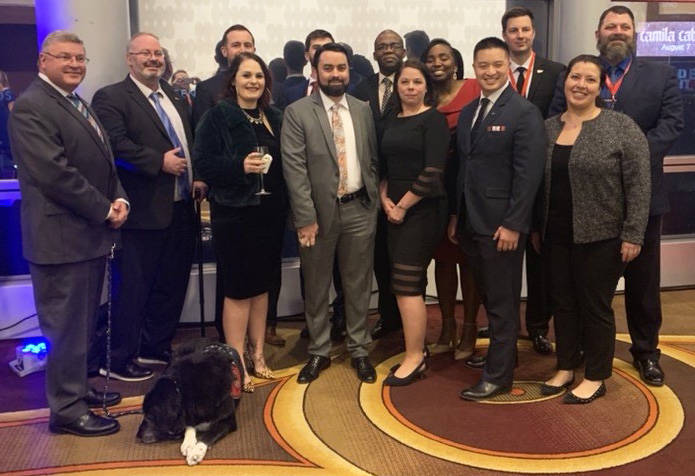 Katherine Cassell and other national fellows are pictured during a Student Veterans of America ...