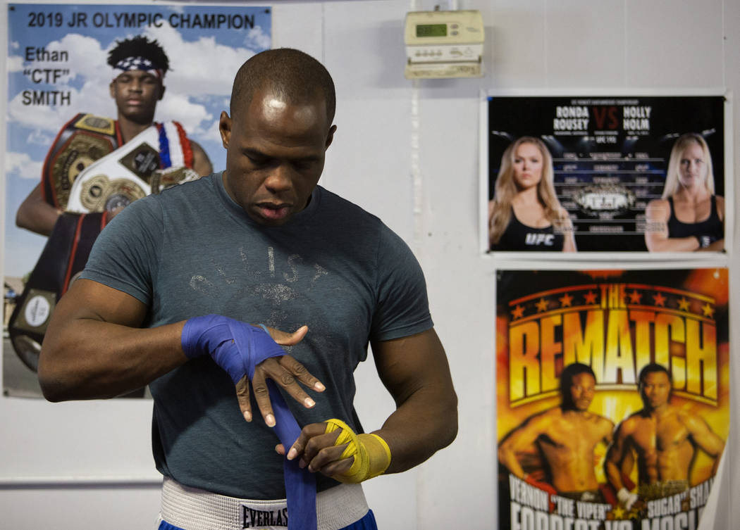 Heavyweight boxer Rubens Nicolas wraps his hands before training on Friday, Jan. 24, 2020, at J ...